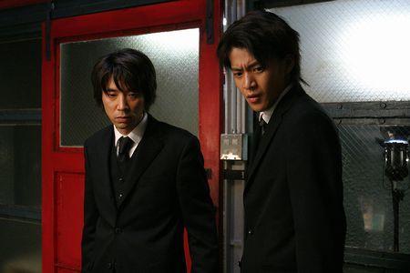 オダ・ユージ(ユースケ・サンタマリア)と家元(小栗旬)
