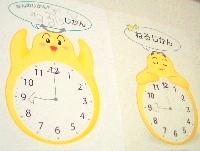 壁に貼った「時間生活術シート 時計のハリー」