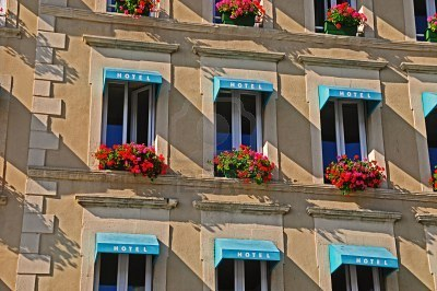 5570626-european-hotel-with-flowered-window-boxes-under-windows-with-awnings.jpg