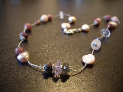 pink tone silk cord station necklace