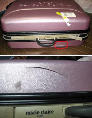 お壊れスーツケース